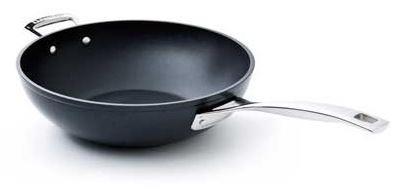 Poele wok les forgees le creuset - Poele en fonte le creuset ...